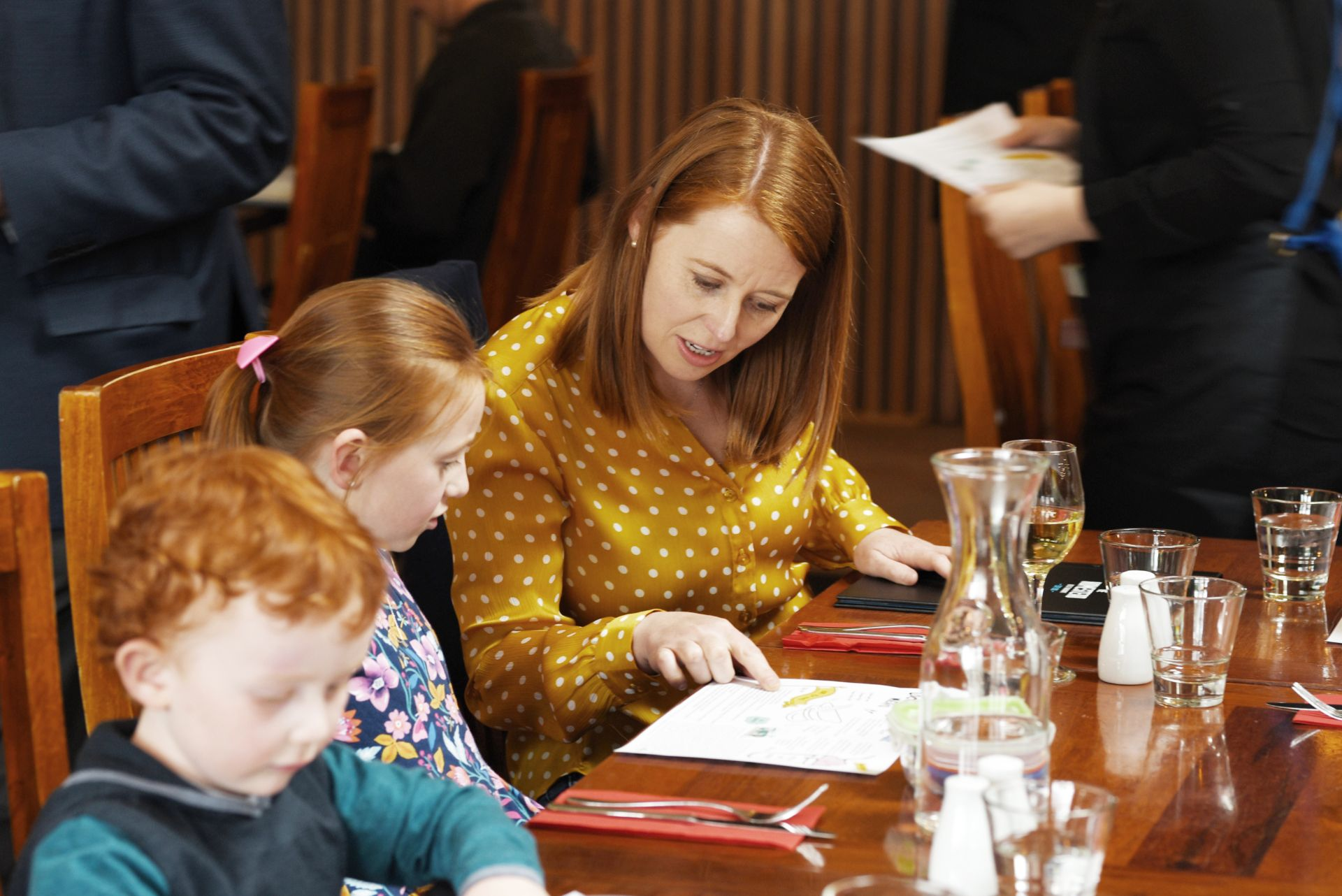 Mother and children checking out the menu at The Homestead Restaurant