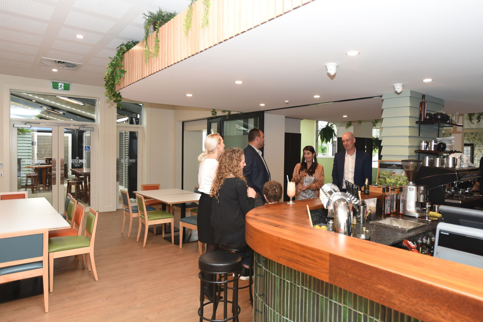 Guests enjoying the bar area at The Homestead