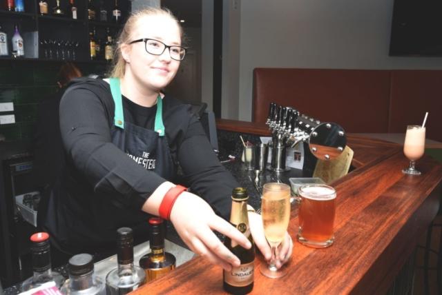 Bar staff serving drinks at The Homestead Restaurant